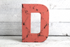 """Wooden"" letter D in pink coral"