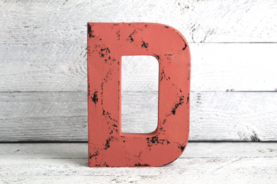 """Wooden"" coral and pink letter D in a vintage style"