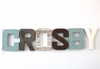 Crosby name sign in blue, white, and brown for baby boys room decor.