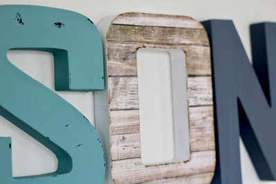 Nursery letters in blues and whites.