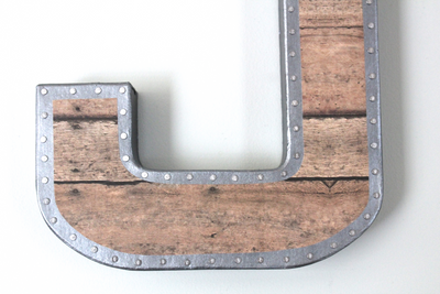 Farmhouse style faux metal and wooden letter with nail head trim design