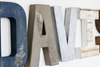 Distressed rustic letters in navy and browns spelling out Davis.