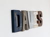 Rustic letters spelling out Davis.