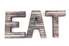 Farmhouse letters spelling out Eat.