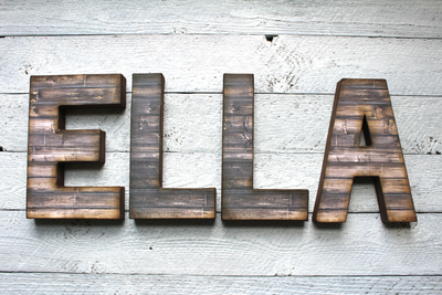 Farmhouse letters spelling out Ella.