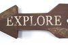 "Custom word explore on a brown ""wooden"" arrow"