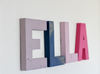 ELLA wall name sign in purple, blue, and pink.