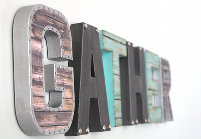 "Gather wall sign in silver, blue, and ""metal"""