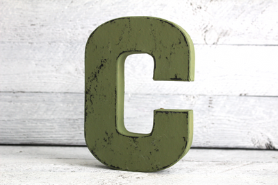 "Green ""wooden"" letter C in a vintage style"