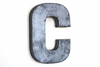 "Silver gray letter C in a rusty ""metal"" look"