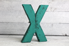 Teal bohemian style letter X in a vintage distressed style