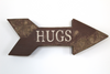 """Wooden"" Distressed Nursery Room Arrow with the word HUGS"
