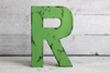 Bright green letter R distressed with black freestanding