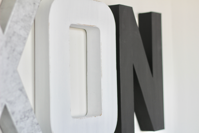 Black, silver, and white monochrome nursery letters.
