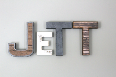 Custom wall letters spelling out the name Jett for a boys modern farmhouse nursery.