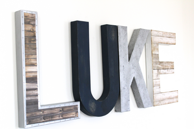 Rustic farmhouse LUKE letters in navy and silver.