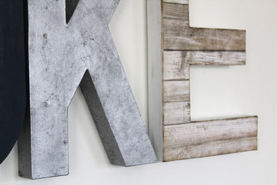 Customized letters featuring a faux metal silver wall letter and a white faux reclaimed white wood letter for boy room decor.