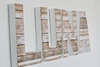 Custom wall letters spelling out the girls name LUNA in a light and airy beach vibe.
