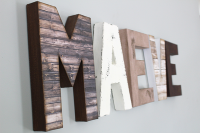 Rustic MAEVE letters on wall for nursery