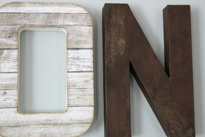 "Distressed ""wooden"" letters O and N in a white and brown color"