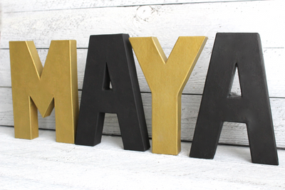 Gold and Black Modern Nursery Letters