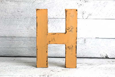 "Freestanding yellow letter ""H"" in an antique yellow color"