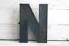 Navy distressed letter N.