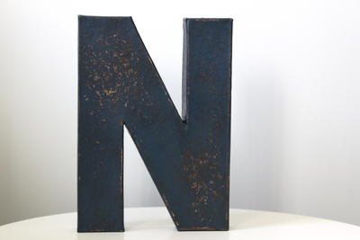 Blue distressed letter N