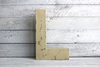 Neutral color wooden letter L for room decor
