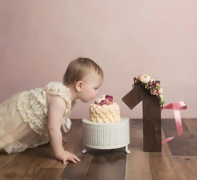 Cute baby girl picture with milestone number 1 for birthday cake smash