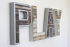 Play wall letters in an industrial farmhouse style with nails going around the letter P and A.