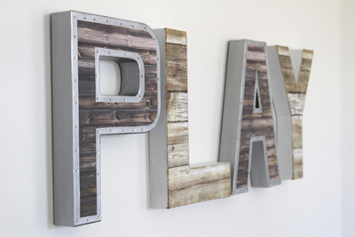 Play letters with an industrial vibe with a nail trim design.