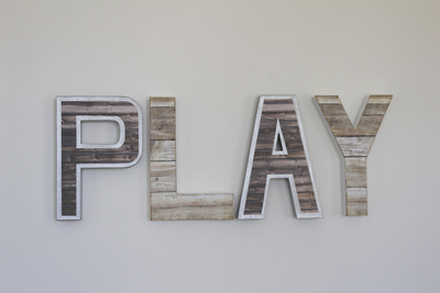 Industrial farmhouse play letters.