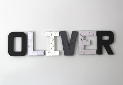 Oliver modern boy nursery custom wall letters in black, silver, and white.