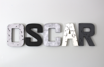 faux wooden and metal letters spelling OSCAR for custom room name decor.