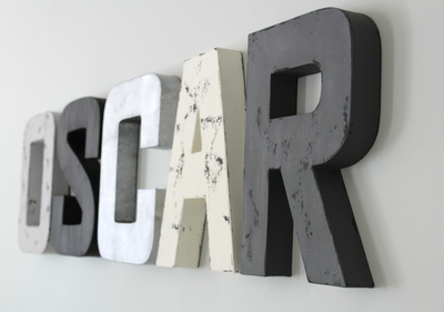OSCAR name sign for boys nursery wall decor in black, white, metal silver, and gray.