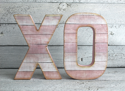 Pink wall letters XO.