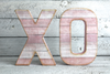 """Wooden"" pink freestanding letters XO"