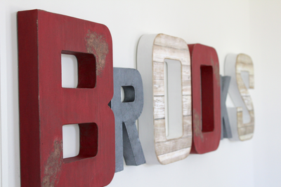 Fire truck bedroom decor wall letters spelling out Brooks in red, white, and grey colors.