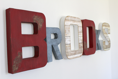 Brooks nursery letters in red, white, and grey colors for a boys fire truck bedroom wall decor.