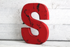 Freestanding red letter S