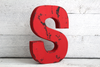 "Red ""wooden"" distressed letter S"