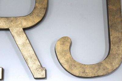 Close up of large RJ initials for nursery decor