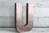 Rose gold freestanding letter U