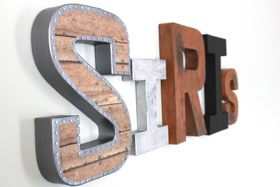 Industrial letters spelling out Siris in different sizes and textures for industrial nurseries.