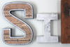 Industrial letters S and I in brown and silver colors.