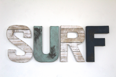 Rustic beach wall decor spelling out surf.