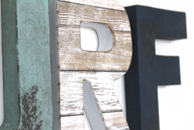 Distressed letters for beach and surf decor.