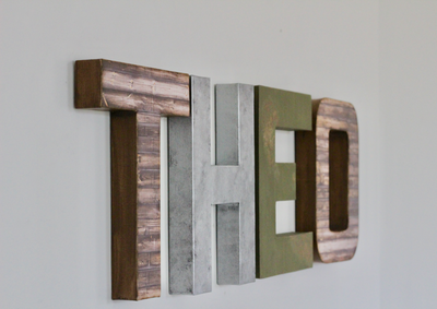 Theo mountain themed nursery letters in brown, silver, and green.