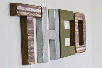 Mountain themed nursery letters spelling out Theo.
